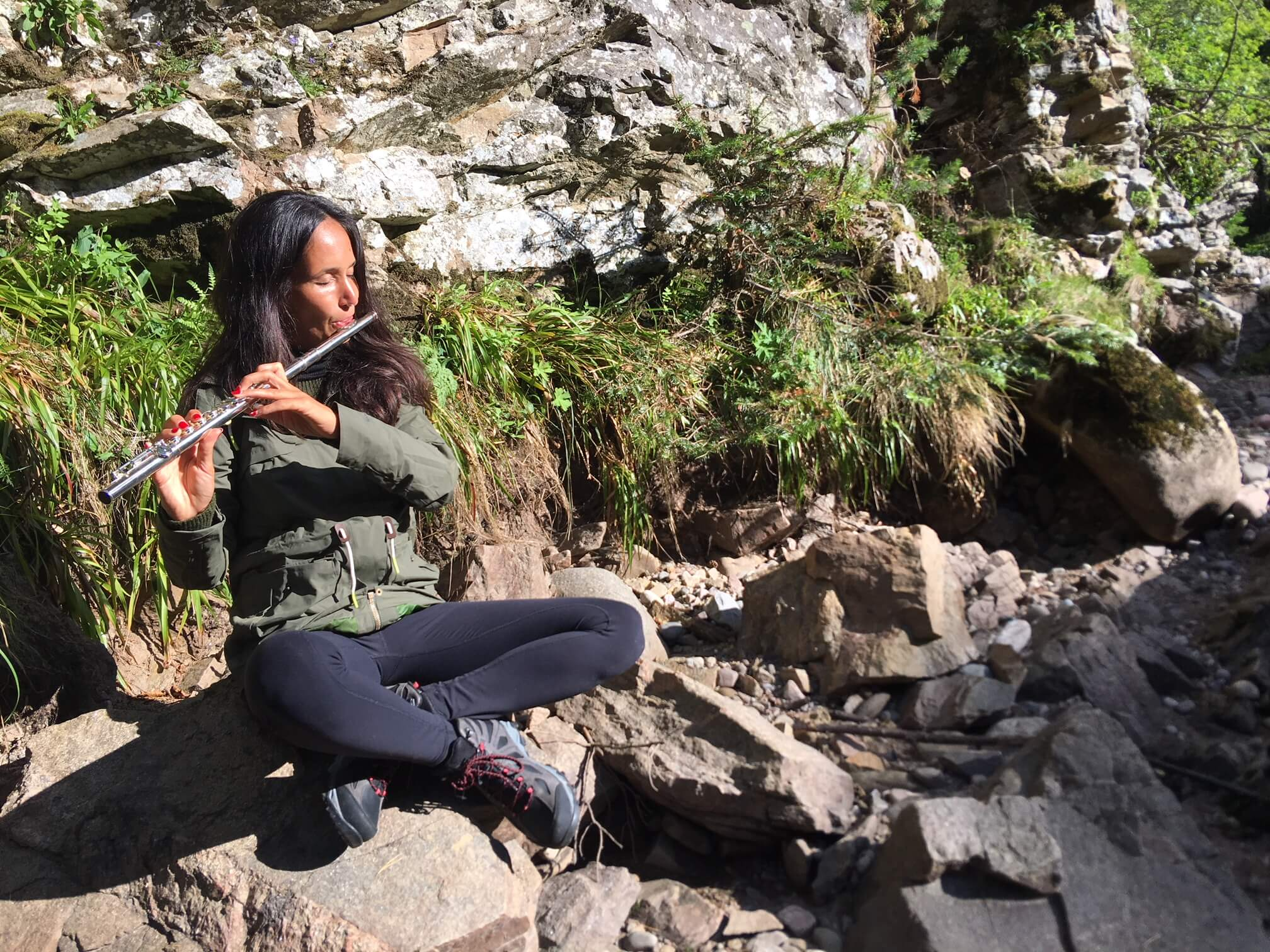 Playing the flute in nature after hiking